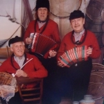 George & Detser with  Luit, our agent in Holland in traditional dress.